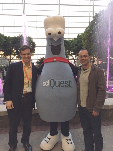 Jason and Xavier with the infamous SciQuest mascot.