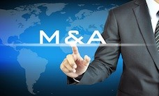 Businessman hand touching M & A on virtual screen - merger & acq