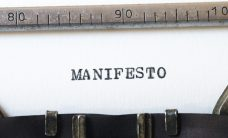 word manifesto typed on typewriter